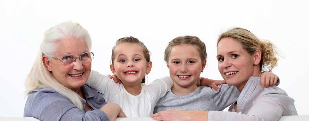 2 smiling children with mother and grandmother